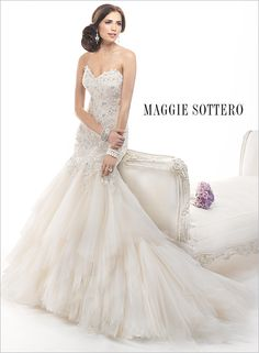 Sahara by Maggie Sottero is a beautiful beaded lace mermaid fit. This wedding gown comes in light gold, ivory, and white and is avaliable at The Bridal Suite in Pensacola. 850-494-9989
