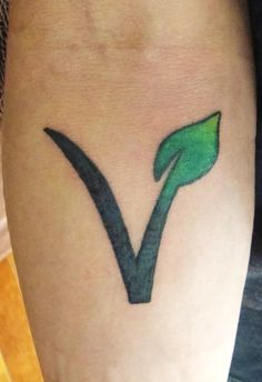 my bf's tattoo, vegan symbol