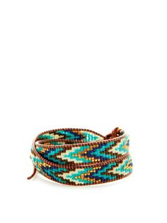 """Tribal Bead Wrap Bracelet. Leather and polyester thread wrap bracelet with tribal print seed bead details      Sterling silver loop and button closure  Measurements: 13"""" long with 2½"""" extension cord, ½"""" wide  Material: Leather, polyester, seed bead, and sterling silver  Brand: Chan Luu. sold out"""