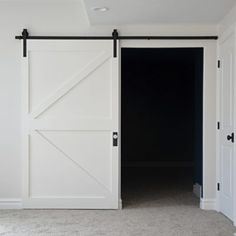Read on as I show you exactly how I constructed this budget friendly British brace barn door and what materials I used! Staircase Makeover, Staircase Molding, Wall Molding, Moulding, Painted Brick Exteriors, Ikea Billy Bookcase, Diy Barn Door, Barn Doors, Faux Shiplap