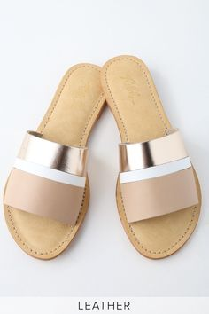 Slide your beach feet into Rebels Harmony Sand Leather Slide Sandals! Genuine leather in stripes of blush, white, and rose gold shape a wide toe-strap atop these trendy slide sandals.