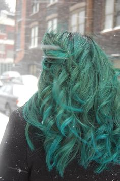 A mixture of the following Manic Panic® hair dye: Enchanted Forest™, Voodoo Blue™, and Atomic™ Turquoise. Pretty!