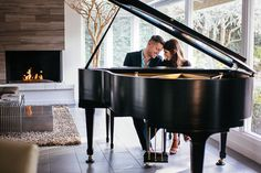 engagement photo of couple playing piano in San Diego home