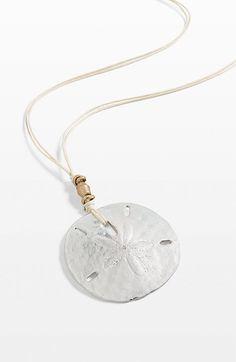 mixed-metal sand dollar pendant necklace