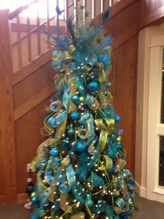 Christmas ~ Aqua And Lime Green Peacock Themed Tree Blue Topperisney Fairy Fantastic Christmas Ideas Fantastic Christmas Tree Topper Ideas. Peppermint Christmas Decorations, Peacock Christmas Decorations, Peacock Christmas Tree, Christmas Tree Angel, Turquoise Christmas, Silver Christmas Tree, Colorful Christmas Tree, Christmas Tree Themes, Green Christmas