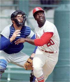 Lou Brock drills one of his 3023 career hits.