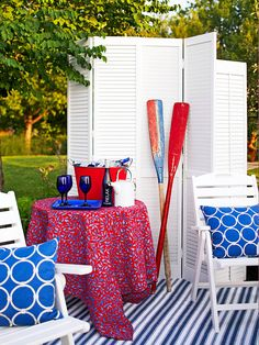 Red and blue accents give this patio nautical flair. Find more patio inspiration: http://www.bhg.com/home-improvement/porch/outdoor-rooms/?socsrc=bhgpin062812