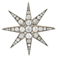 Victorian Silver Topped Diamond Starburst Brooch/Pendant  | From a unique collection of vintage necklace enhancers at https://www.1stdibs.com/jewelry/necklaces/necklace-enhancers/