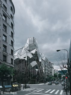 Health Department by Coll-Barreu Arquitectos in Bilbao, Spain. Located in the crossroad of 2 important streets of the Ensanche neighborhood. The restrictive city rules compel to repeat the shape of the neighboring walls, reducing penthouses according to a curved directive, chamfering the corner and building a tower on it. The folded façade generates multiple visual directions from inside to the streets bellow; highly effective mechanism for the incorporation of urban vitality inside the…