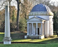 Garden Temple and Obelisk at Chiswick House. Erected in 1732, the Obelisk has built into its base an ancient Hellenistic sculpture of a man and a woman which had been given to the young Burlington in 1712.