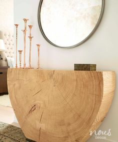 A natural element creates a dramatic entry table
