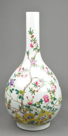 Chinese Famille Rose enameled porcelain vase; pear-shaped body featuring auspicious pomegranates borne on branches, supported on short foot rim; six-character Kangxi Mark within double circles on base; H: 45 cm, D: 24.5 cm