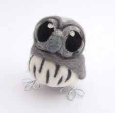 This is a lovely needle felted soft grey baby owl, he is very impatient and always reads the last page of the book first just to make sure it has