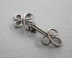 This Celtic knot cardigan clasp or sweater clasp closure is handmade with 14 gauge copper wire, hammered, tumbled for hours for more strength and for