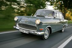 An older version of the Opel Olympia Rekord Caravan as seen on the pervious Adlerwart photo, with a grille that does remind of Chevrolets of the time.