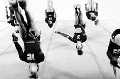 Members of the University of Oregon Acro Team (Acrobatics & Tumbling) practice a synchronized flip. [source: Lightbox/TIME Magazine]