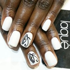 White gel manicure with decal and Swarovski Crystal