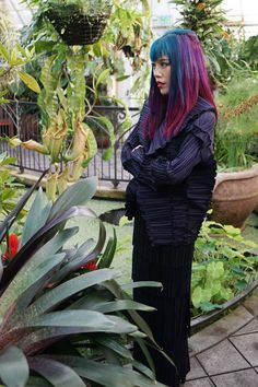 La Carmina wears Japanese couture - pleats jacket and skirt by Issey Miyake - in the San Francisco Conservatory of Flowers. See more on her Tokyo hip fashion blog: http://www.lacarmina.com/blog/2015/02/kimono-model-torso-vintages-conservatory-of-flowers/  blue purple red colored hair