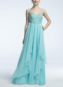 Show up and show out in this stunning prom dress!  Features ultra-feminine sweetheart neckline with dazzling beaded bust.  Empire bodice flows into long soft layers of chiffon that gives this dress a whimsical feel.  Fully lined. Back zip. Imported polyester.  Professionally spot clean only. Ornamentation must be properly covered, no direct steam or heat on garment or beading.  Also available in Plus sizes as Style 7608W.