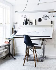 Even with lots going on in this office, the black and white pallet keeps everything looking organized