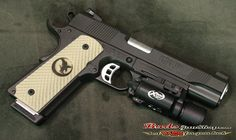 This Nighthawk Custom is a GRP RECON .45acp 1911 in all black Permakote finish. This gun features all steel construction, accessory rail, checkered front strap and mainspring housing with inte