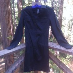 Black jacket dress Black cotton ploy spandex blend, knee length, button front shirt dress... Can be worn as a dress straight or belted , buttoned up or over something else unbuttoned ... Many button and stem details for added interest. fylo Jackets & Coats