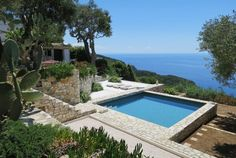 Vacation home rentals and short term house rentals in Greece Villas, cottages, cabins, beach house rentals, pet friendly and more. Vacation Homes For Rent, Vacation Home Rentals, House Rentals, Life In Greek, Paxos Greece, Greece Vacation, Boutique Homes, Luxury Holidays, Terrace Garden