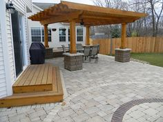 Patio with wooden steps and stone wall by Culvers Garden, via Flickr