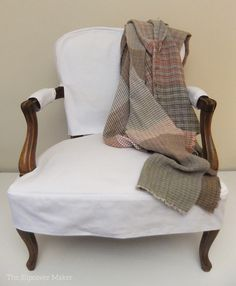 Casual white denim slipcover custom made for a vintage French chair. Simple and chic.