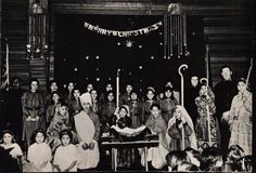 B&W photo taken in Juneau, Alaska in 1930 at the Salvation Army Congress. The photo is of the first Girl Guard troop in Alaska performing their Christmas program. Standing with the children in the program are Captain and Mrs. Jackson (far right) and Mrs. Brigadier Lesher (left). They are posing in the manger scene with three wisemen, the baby Jesus and choir in the background. Classic Army, Juneau Alaska, Christmas Program, Baby Jesus, First Girl, Choir, Troops, The One, Jackson
