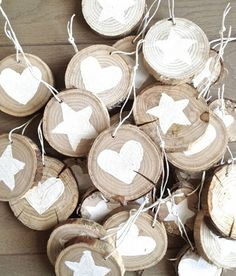 handmade wooden ornaments ... tree slices decorated with white stenciled or stamped images ... great for outdoor tree or bare branch decorations ...