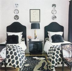 eclectic + chic black and white shared bedroom.  black headboards + lacquered chest + brass lamp + ikat | simon kelly