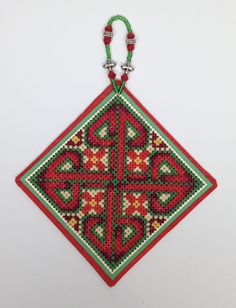 Counted cross stitch pattern from the Celtic Series of Frony Ritter Designs. Pattern name is Missal of Leofric and conversion to Christmas colors is on the website Fronyritterdesigns.com.