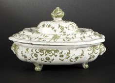 Earthenware 3 legged soup tureen and cover with green camaïeu decoration of grotesque masks, fantasy birds and flowered sprigs and satyr head finials on three feet by Moustierse