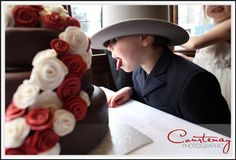 Small boy, big top hat, HUGE chocolate wedding cake...