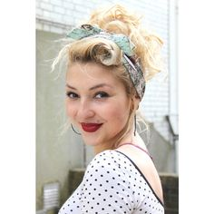 Vintage up-do with world map headscarf.