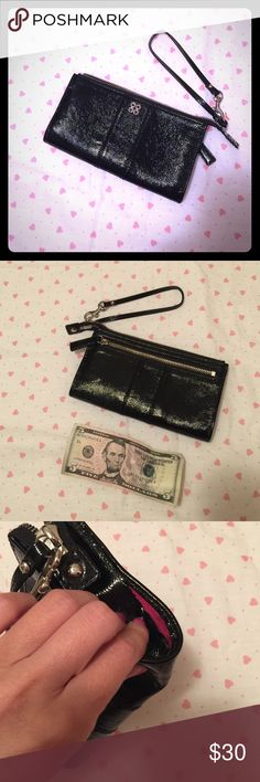Coach wristlet Wallet is in perfect condition on the outside. NOTE: there is an inch long tear at the seam. Can probably be sewed up. I purchased this from Nordstrom about three years ago. Inside has 3 minor marks. Wallet looks new, other than the tear (see in photo) Coach Bags Clutches & Wristlets