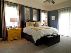 Interior design enthusiast and HGTV Star contestant Jeribai Tascoe created this master bedroom with some serious repurposing. Tascoe enjoys creating edgy spaces that feature an element of fun. In this stylish blue bedroom he painted the nightstands in bold yellow to let them stand out and to give them a fresh feel.