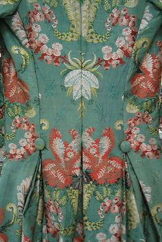 Detail back view, robe à la Polonaise, France, 1774-1793. Green silk brocaded with floral motifs.