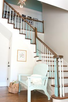 Painted stairs: White painted staircase with ombre gradient painted balusters/spindles in muted teal blue and aqua colors. From Kristie Barnett, The Decorologist via Houzz.
