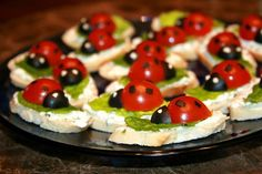 Cherry tomatoes ladybug appetizers! Can use bread or fresh mozzarella for the base.