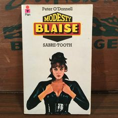 Modesty Blaise Sabre-Tooth by Peter O'Donnell Vintage Paperback 1977 Pan Books UK Crime Fiction Comic Strip Character by vintagebaron on Etsy