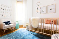Tour this gender neutral nursery filled with mid-century modern style, DIY nursery artwork and a perfectly styled book shelf.