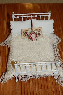 pretty crocheted coverlet for dollhouse bed - the site has a closeup photos of the coverlet