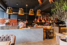 The color scheme consists of light colors, soft furniture and lots of wood create a pleasant, tranquil setting. The interior design is made in a modern style, but with thematic details that set the mood. These are wicker baskets, and copper pans on the ceiling, and showcases with Italian delicacies.