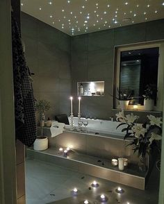 "This bathroom is a little *too* modern for me, however I love the ""starry sky"" lights above the bath. Reminds me of a feature they have in the Cinderella Castle Suite at the Magic Kingdom."