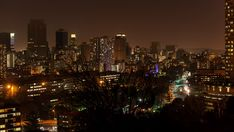 An urban timelapse with a colourful display of nighttime traffic, streets and buildings at Ponte Tower in the city centre of Johannesburg. Seattle Skyline, New York Skyline, City Scene, Hd Video, Night Time, Stock Footage, Centre, Buildings, Africa