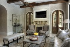 Love the doors, beamed ceilings.  But i'd want cathedral ceiling  Love this living family room!!! Parisian Chateau :: view from kitchen to outdoor kitchen, beyond french doors :: view 2 of 4