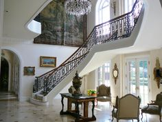 I designed the stair hall from a narrow passage widen by several feet to accommodate the  Louis XVI wrought iron staircase and wall for the 18th century Beauvais tapestry. Early Empire period center table.