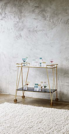 Bring some instant glamour to your parties with this striking and elegant drinks trolley.